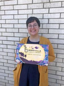 Kelly Ramirez holding her winning mural design.