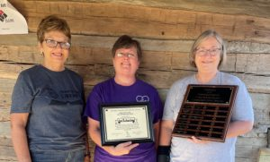 Carol Ann Engskov and Carol Youngblood present the Carla Young Community Spirit Award to Ann Richardson.
